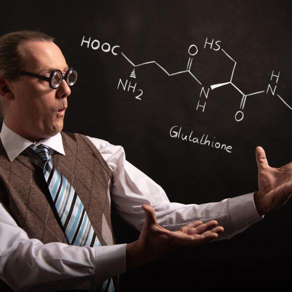 Professor presenting handdrawn chemical formula of Glutathione antioxidant peptide